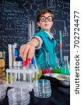 smart boy scientist making... | Shutterstock . vector #702724477