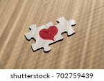 two pieces of puzzle in love   Shutterstock . vector #702759439