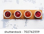 bowls of various tomato sauces... | Shutterstock . vector #702762559