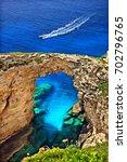 "Small photo of Trypitos (also known as ""Kamara""), a natural rocky ""bridge"" at Paxos island, Kerkyra (""Corfu"") prefecture, Ionian Sea, Greece. Date taken: 7.6.2013."