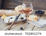 a glass of rose wine served... | Shutterstock . vector #702801274