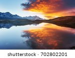 sunset on mountain lake koruldi.... | Shutterstock . vector #702802201