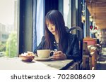 young asian women in the cafe | Shutterstock . vector #702808609