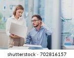 business team working on a... | Shutterstock . vector #702816157