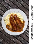 sausage and mash with onion... | Shutterstock . vector #702819904