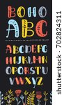 Vector cartoon Boho colorful alphabet. Vector ethnic letters and arrows. Cute and funny ABC uppercase letters on dartk background, decorated with flowers for your design.