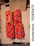 Small photo of Bags of acerola cherries with price tag in Belem do Para, Brazil.