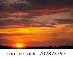 fiery  orange and red dramatic... | Shutterstock . vector #702878797