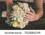 hands and rings on wedding... | Shutterstock . vector #702886249