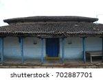 rural village poor house | Shutterstock . vector #702887701