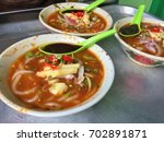 delicious laksa in penang that... | Shutterstock . vector #702891871