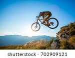 professional rider is jumping... | Shutterstock . vector #702909121