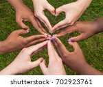 black and white hands in heart... | Shutterstock . vector #702923761