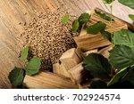 wooden pellet bio fuel   Shutterstock . vector #702924574