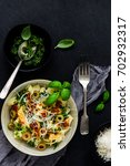 tagliatelle pasta with red and... | Shutterstock . vector #702932317