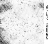 grunge halftone black and white.... | Shutterstock . vector #702942487