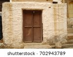 antic wood door | Shutterstock . vector #702943789