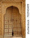 antic wood door  | Shutterstock . vector #702945499