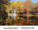 colorful autumn trees in the... | Shutterstock . vector #702945739
