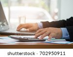 a businessman analyzing... | Shutterstock . vector #702950911