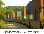 a long freight train with many... | Shutterstock . vector #702953044