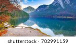 Wooden Bench On Alpsee Lake...