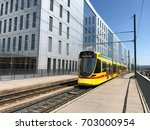 tram in a city | Shutterstock . vector #703000954