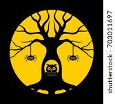 halloween  gnarled tree  owl in ... | Shutterstock .eps vector #703011697