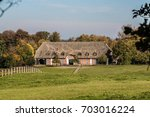 farmhouse in north germany | Shutterstock . vector #703016224