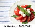 tomato mozzarella cheese and... | Shutterstock . vector #703023841