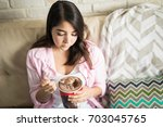 cute young woman depressed... | Shutterstock . vector #703045765