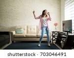 independent woman singing... | Shutterstock . vector #703046491