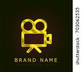 video camera golden metallic...
