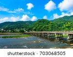 togetsukyo bridge in arashiyama ... | Shutterstock . vector #703068505