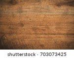 old grunge dark textured wooden ...   Shutterstock . vector #703073425