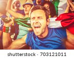 italian supporter at the... | Shutterstock . vector #703121011