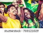 brazilian supporters cheering... | Shutterstock . vector #703121029