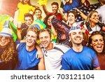multiple nations' fans at... | Shutterstock . vector #703121104