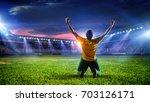 soccer player at stadium. mixed ... | Shutterstock . vector #703126171