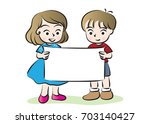 boy and girl holding blank... | Shutterstock .eps vector #703140427