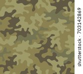 seamless camouflage pattern.... | Shutterstock .eps vector #703142869