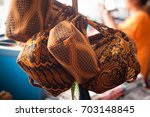 a traditional batik pattern bag ... | Shutterstock . vector #703148845