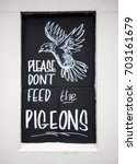 Small photo of Don't Feed The Pigeons sign