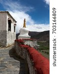 Small photo of There is the right path to enlightenment.Follow Buddha's teaching to nirvana.White stupa(pagoda) at Yumbulakhang palace,first building in Tibet,in Yarlung valley in Tsetang city,China.