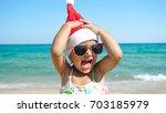 a little girl is having fun and ... | Shutterstock . vector #703185979
