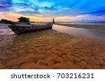 beach and wooden boat in phuket ... | Shutterstock . vector #703216231