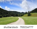 small street in the bavarian... | Shutterstock . vector #703216777