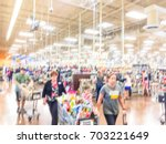 blurred image a busy cashier... | Shutterstock . vector #703221649
