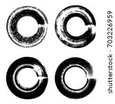 grunge paintbrush circle... | Shutterstock .eps vector #703226959