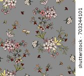 seamless floral pattern in... | Shutterstock .eps vector #703244101